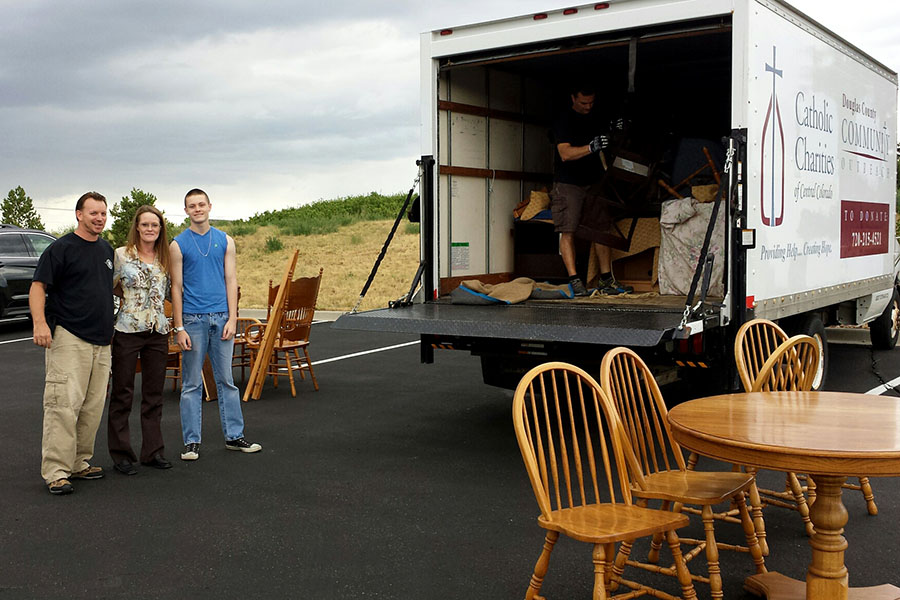 folks loading a truck full of furniture Castle Rock Office Outreach