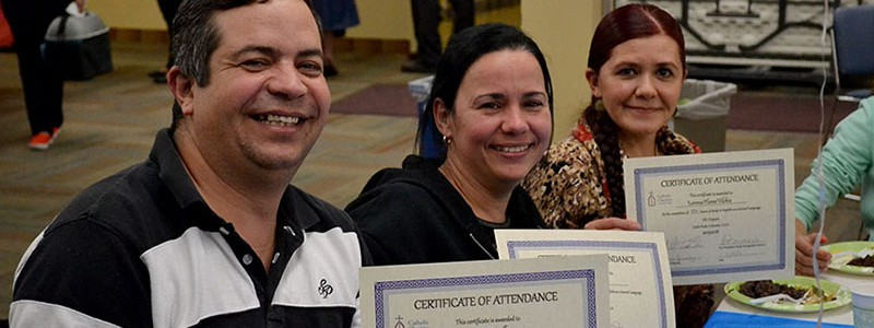 family-holding-up-esl-certificates