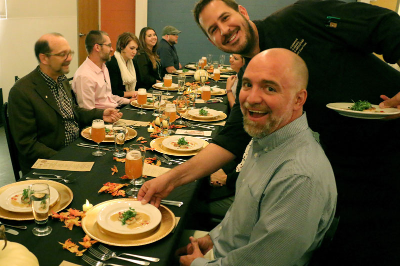 A picture of a Beer Dinner including a server and CEO Andy Barton