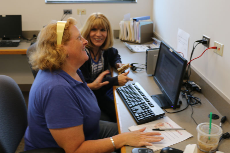 Sherry Stulpin (left) assists a Sarah (right) in the Life Skills & Career Development Center