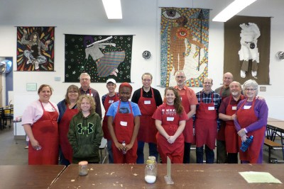 a group of 13 volunteers in marian house dining room