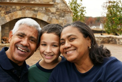A picture of a smiling family for immigration awareness month
