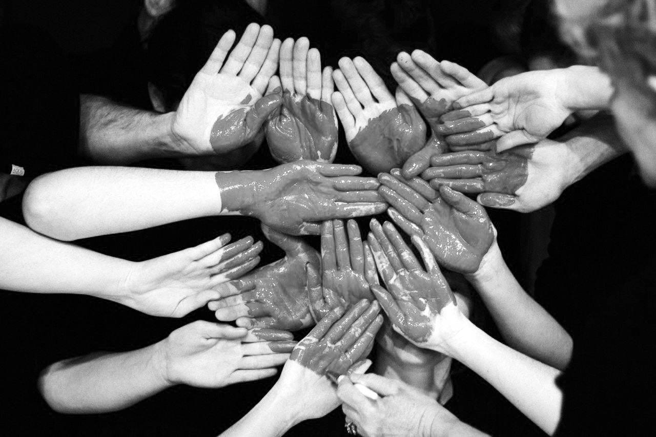 A group of hands with a painted heart on them