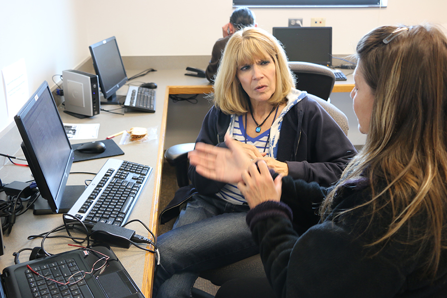 Life Skills and Career Development Center - Computer Lab with Client Working with Case Manager