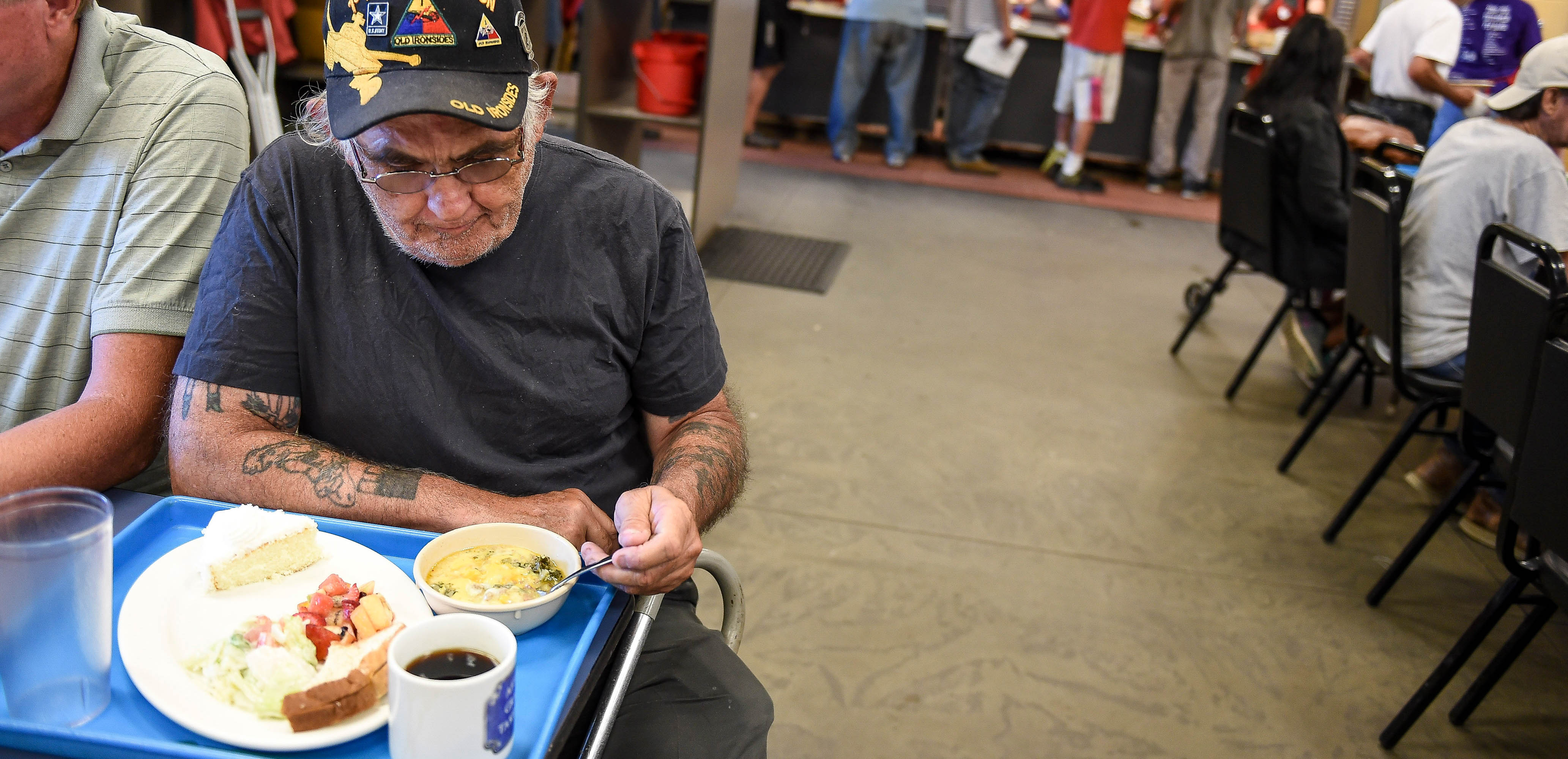 Man eating food at Marian House Soup Kitchen