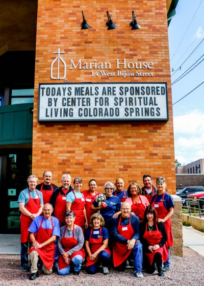 Marque on Marian House with Sponsor a Day Messaging with a group of volunteers from Center for Spiritual Living