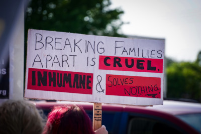 sign that says Breaking Families apart if cruel, inhumane, and solves nothing