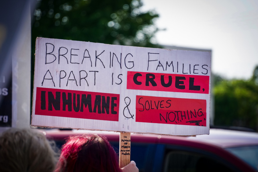 sign that says Breaking Families apart is cruel, inhumane, and solves nothing