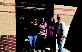 picture of Catholic Charities staff in front of new office