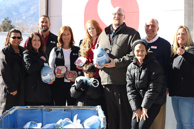 picture of safeway and catholic charities staff with turkey meals