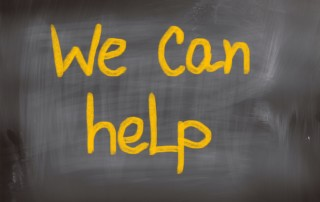 sign saying we can help
